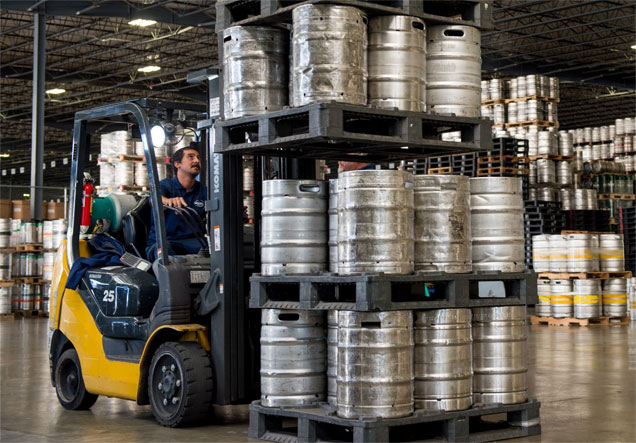 Forklift carrying kegs